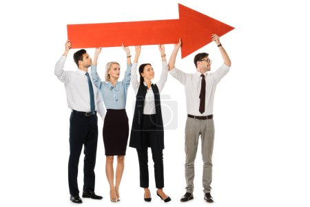 young businesspeople holding big red arrow isolated on white