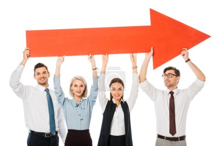 young successful business team holding big red arrow isolated on white