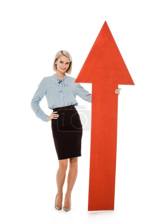 young businesswoman standing with big red arrow isolated on white