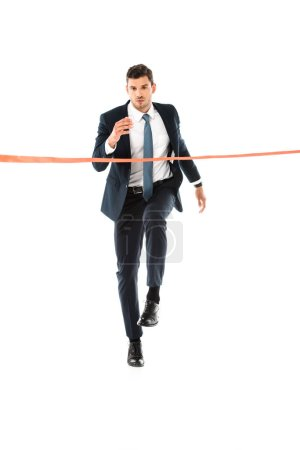 handsome businessman in suit running to finishing line isolated on white