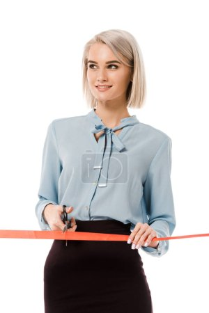 blonde businesswoman cutting red ribbon with scissors for grand opening, isolated on white