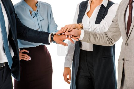 cropped view of business team putting hands together isolated on white