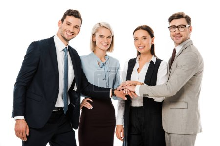 Photo for Smiling successful business team putting hands together isolated on white - Royalty Free Image