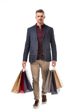 Photo for Stylish adult man in jacket holding colorful shopping bags isolated on white - Royalty Free Image