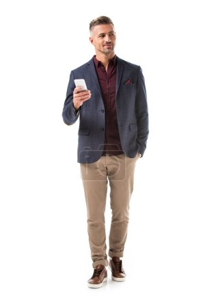 Photo for Handsome adult stylish man in jacket using smartphone isolated on white - Royalty Free Image