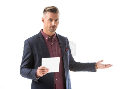 Photo for Man in jacket holding digital tablet and doing invite gesture isolated on white - Royalty Free Image