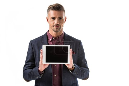 handsome stylish man in jacket showing digital tablet with blank screen isolated on white