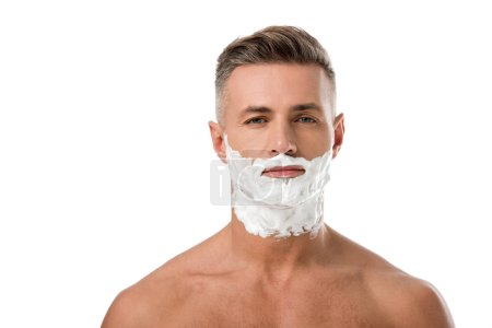 portrait of adult man with shaving foam on face looking at camera isolated on white