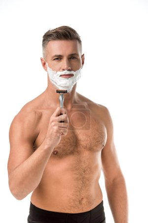 Photo for Adult man with foam on face shaving with razor isolated on white - Royalty Free Image