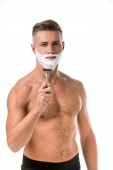 adult man with foam on face shaving with razor isolated on white
