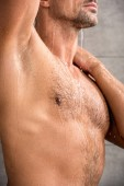 cropped image of man with muscular torso taking shower in morning