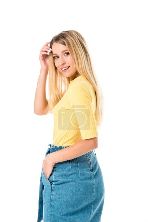 side view of beautiful young woman smiling at camera isolated on white