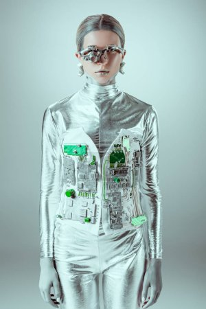 futuristic silver cyborg looking at camera isolated on grey, future technology concept
