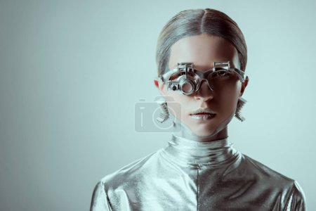 futuristic silver robot looking at camera isolated on grey, future technology concept