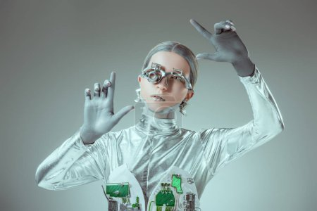 futuristic silver robot gesturing with hands isolated on grey, future technology concept
