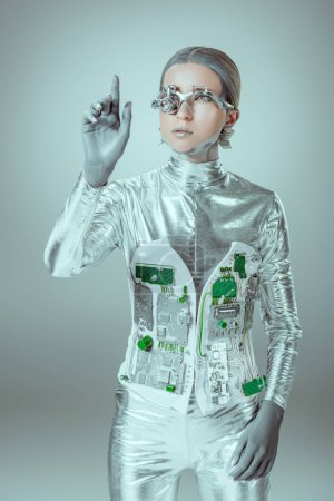 young woman robot gesturing with hand on grey, future technology concept
