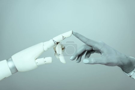 Photo for Cropped shot of cyborg touching robotic arm isolated on grey, future technology concept - Royalty Free Image