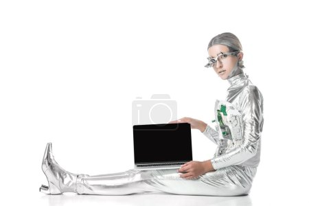 Photo for Silver robot sitting and showing laptop with blank screen isolated on white, future technology concept - Royalty Free Image