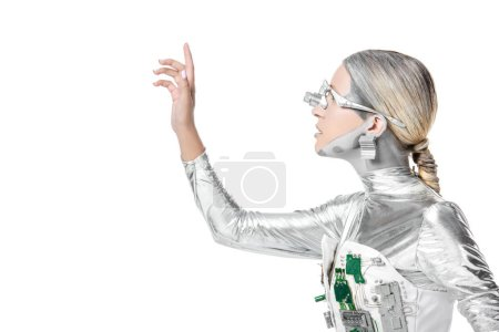 Photo for Side view of silver robot touching something isolated on white, future technology concept - Royalty Free Image