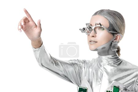 Photo for Portrait of silver cyborg touching something isolated on white, future technology concept - Royalty Free Image