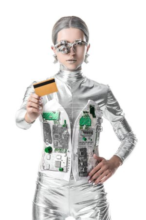 silver robot showing credit card isolated on white, future technology concept