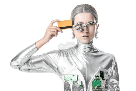 silver robot touching head with credit card isolated on white, future technology concept