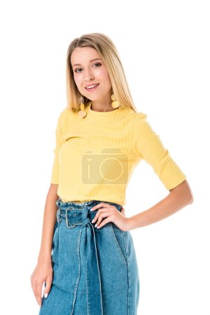 Photo for Attractive woman posing in yellow shirt and looking at camera isolated on white - Royalty Free Image