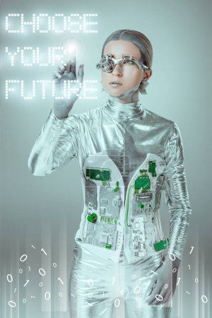 "Photo for Young cyborg touching ""choose your future"" lettering on grey with digital data, future technology concept - Royalty Free Image"