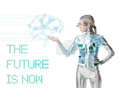 "silver cyborg holding digital data isolated on white with ""the future is now"" lettering, future technology concept"