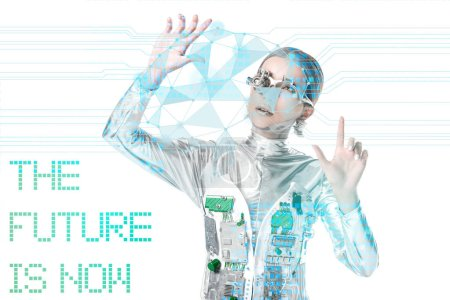 "silver cyborg looking at digital data isolated on white with ""the future is now"" lettering"