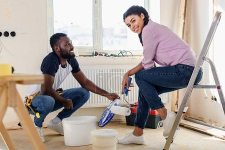happy young couple relaxing while making renovation of home