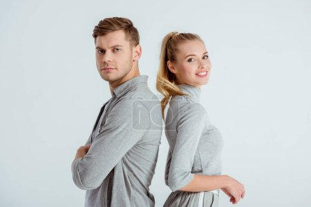 Photo for Serious man and beautiful smiling woman posing together isolated on grey - Royalty Free Image