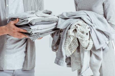 Foto de Vista recortada de la pareja con ropa gris aislado en gris - Imagen libre de derechos