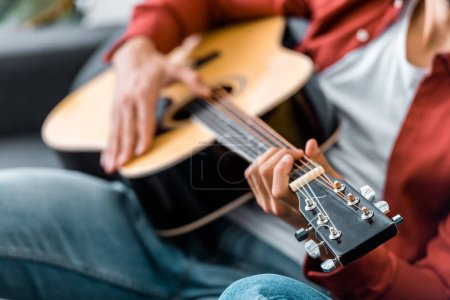 Photo for Partial view of adult man playing guitar - Royalty Free Image