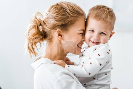 Photo for Close up view of attractive mother embracing cute toddler son - Royalty Free Image