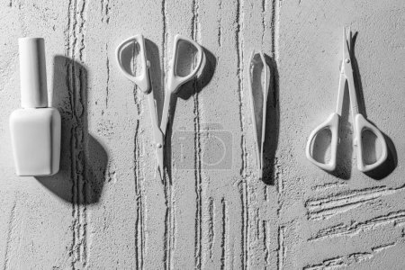 Photo for Close-up view of decorative manicure tools on wall in beauty salon - Royalty Free Image