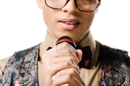 Photo for Partial view of young male mixed race musician in eyeglasses singing in microphone isolated on white - Royalty Free Image