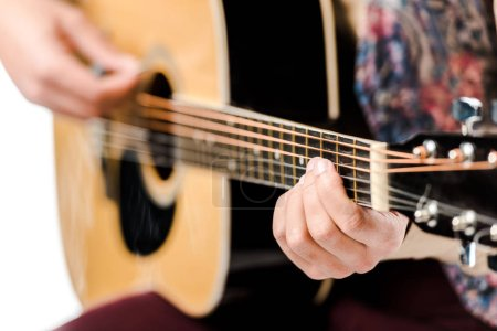Photo for Selective focus of male musician playing on acoustic guitar isolated on white - Royalty Free Image
