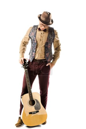 Photo for Male musician in hat and eyeglasses posing with acoustic guitar isolated on white - Royalty Free Image