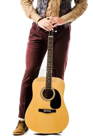 cropped shot of stylish male musician posing with acoustic guitar isolated on white