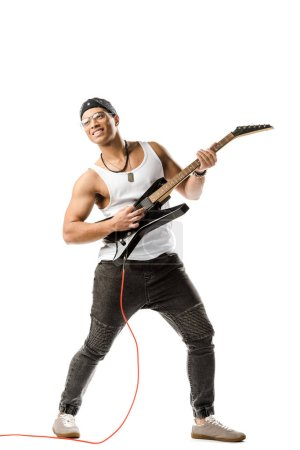 happy mixed race male rock musician playing on electric guitar isolated on white