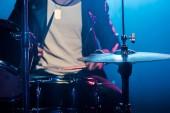 """Постер, картина, фотообои """"обрезанное изображение мужской музыкант играет барабаны во время рок-концерт на сцене с дымом и драматическое освещение"""""""
