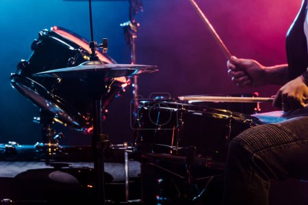 Photo for Cropped shot of male musician performing on drums during rock concert on stage - Royalty Free Image