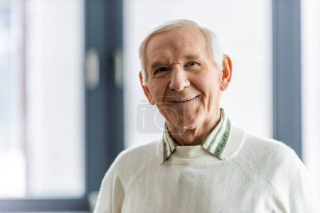 Photo for Close up portrait of smiling senior man looking at camera - Royalty Free Image