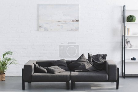 cozy grey sofa in modern living room interior