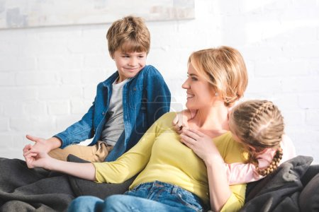 Photo for Happy mother and cute little children spending time together at home - Royalty Free Image
