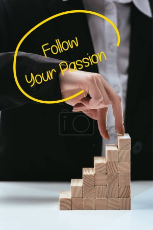 Photo for Cropped view of woman climbing with fingers wooden career ladder, 'follow your passion' lettering on foreground - Royalty Free Image