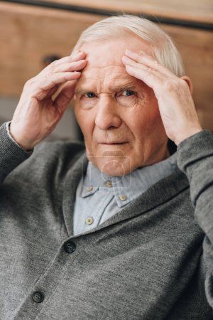 Photo for Senior man with grey hair having headache - Royalty Free Image
