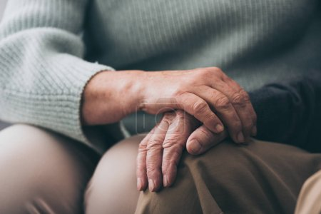 Photo for Cropped view of senior woman holding hands with retired husband - Royalty Free Image