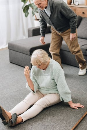 retired husband coming to upset wife sitting on floor